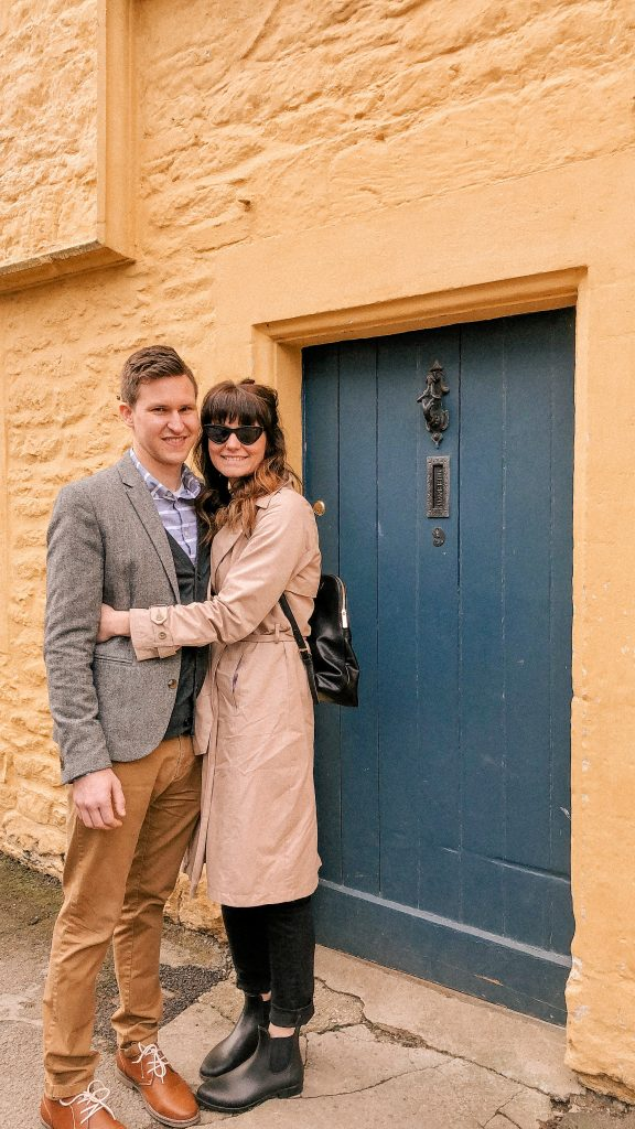 Lacock, Wiltshire, Cotswolds, UK, National Trust, England, English Countryside, girls love travel, target trench coat, a new day target, travel style, messy bun, i have this thing with doors