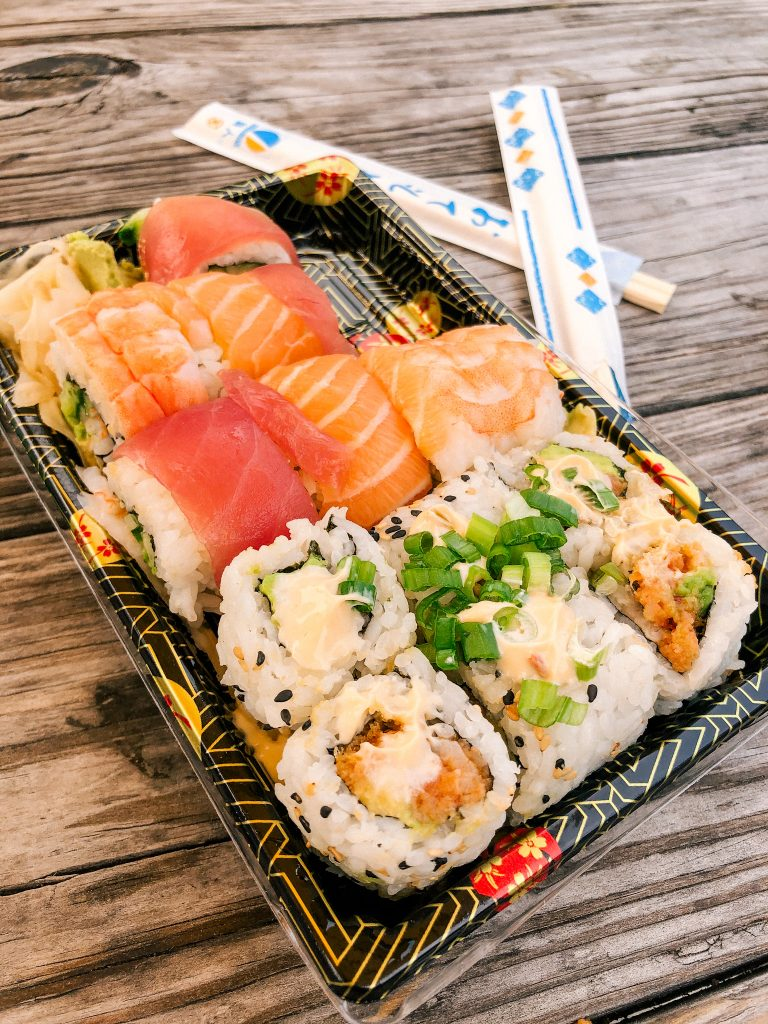 Spicy salmon and Rainbow sushi roll take out