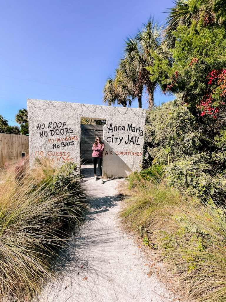 girl posing at historic open air Anna Maria City Jail on Anna Maria Island, FL